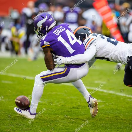 Chicago, Illinois, U.S. - Bears #20 Prince Amukamara knocks the ball loose from Vikings #14 Stefon Diggs during the NFL Game between the Minnesota Vikings and Chicago Bears at Soldier Field in Chicago, IL. Photographer: Mike Wulf