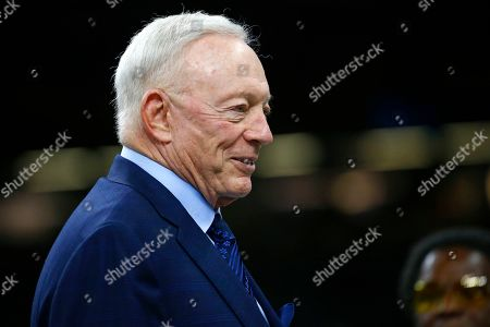 Dallas Cowboys owner Jerry Jones talks on the field before an NFL football game against the New Orleans Saints in New Orleans