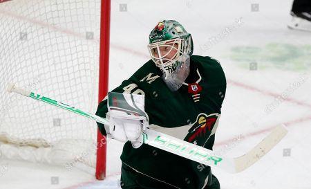 Jets Wild Hockey. Minnesota Wild goalie Devan Dubnyk against the Winnipeg Jets in the third period of an NHL hockey game in St. Paul, Minn