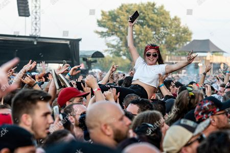 Benjamin Burnley. A festivalgoer crowd surfs as Breaking Benjamin performs during Louder Than Life at Highland Festival Grounds at KY Expo Center, in Louisville, Ky