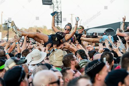 Benjamin Burnley. Festivalgoers crowd surf as Breaking Benjamin performs during Louder Than Life at Highland Festival Grounds at KY Expo Center, in Louisville, Ky