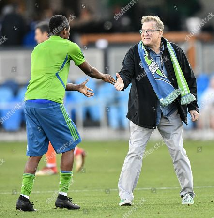 Drew Carey celebrates with his players on the field after the MLS match between the Seattle Sounders and the San Jose Earthquakes at Avaya Stadium in San Jose, California