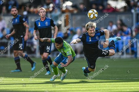 Stock Photo of San Jose Earthquakes midfielder Florian Jungwirth (23) and Seattle Sounders forward Raul Ruidiaz (9) chase a ball during the MLS match between the Seattle Sounders and the San Jose Earthquakes at Avaya Stadium in San Jose, California