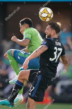 San Jose Earthquakes defender Guram Kashia (37) heads the ball away from Seattle Sounders forward Raul Ruidiaz, left, during the first half of an MLS soccer match, in San Jose, Calif