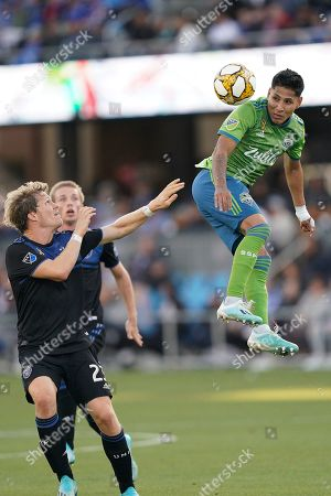 Stock Image of Seattle Sounders forward Raul Ruidiaz (9) goes up for a header in front San Jose Earthquakes midfielder Florian Jungwirth (23) during the second half of an MLS soccer match, in San Jose, Calif. The Seattle Sounders won 1-0
