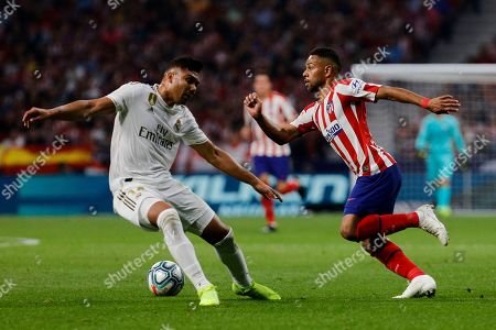 Renan Lodi of Atlético Madrid and Carlos Henrique Casimiro of Real Madrid