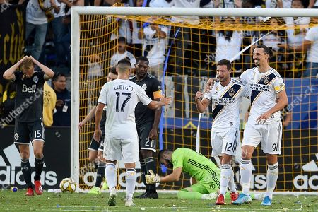 Stock Image of Zlatan Ibrahimovic, Chris Pontius. LA Galaxy forward Chris Pontius, second from right, celebrates his goal with forward Zlatan Ibrahimovic, right, during the second half of an MLS soccer match against Vancouver Whitecaps FC in Carson, Calif., . The Whitecaps won 4-3