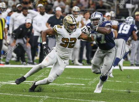 New Orleans Saints defensive end Marcus Davenport (92) beats Dallas Cowboy's offensive lineman Tyron Smith (77) around the edge during NFL game action between the New Orleans Saints and the Dallas Cowboys at the Mercedes Benz Superdome in New Orleans, LA