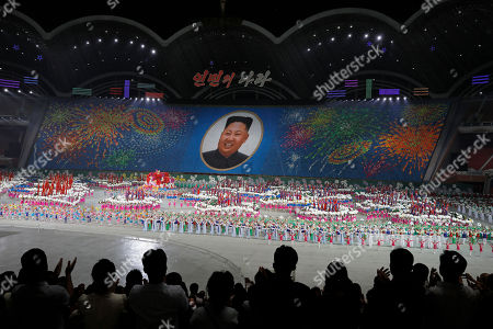 """North Koreans hold cards to make an image depicting of their leader Kim Jong Un during a mass game performance of """"The Land of the People"""" at the May Day Stadium in Pyongyang, North Korea. North Korea has now officially """"enshrined 'self-reliance and self-development' ... as the new major ideological theme of the Kim Jong Un era, in place of Kim Jong Il's military"""