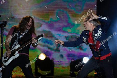 Stock Picture of Bon Jovi lead singer Jon Bon Jovi, right, and guitarist Phil X perform at the Rock in Rio music festival in Rio de Janeiro, Brazil, early