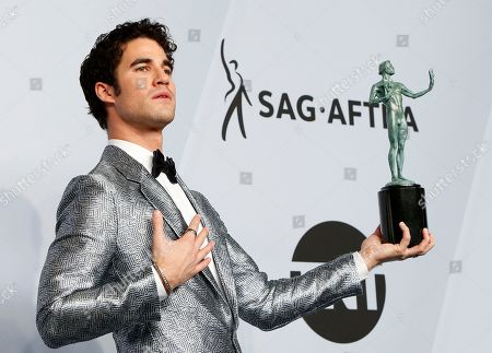 Darren Criss poses with the SAG Award for Outstanding Performance by a Male Actor in a Miniseries or Television Movie in 'The Assassination of Gianni Versace: American Crime Story' during the 25th annual Screen Actors Guild Awards ceremony at the Shrine Auditorium in Los Angeles, California, USA, 27 January 2019.