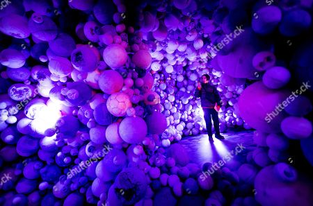 A visitor views the installation 'Amethyst Ball Cavern' by the New York artist Daniel Arsham on display at his solo exhibition 'Connecting Tim' at the Moco Museum in Amstredam, The Netherlands, 18 January 2019. Arsham incorporates various disciplines, such as architecture, design, sculpture, film and fine art into his works.