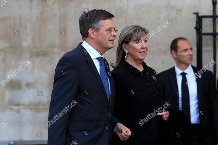 Stock Image of Former Dutch Prime Minister Jan-Peter Balkenende, left, arrives at Saint Sulpice church in Paris, where past and current heads of states gathered to pay tribute to former French president Jacques Chirac who died last week at the age of 86