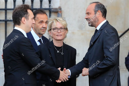 French Prime Minister Edouard Philippe, right, greets Martin Rey-Chirac, left, and Claude Chirac, second right, son and daughter of former PresidentJacques Chirac outside Saint Sulpice Church in Paris, where past and current heads of states gathered to pay tribute to Chirac who died last week at the age of 86