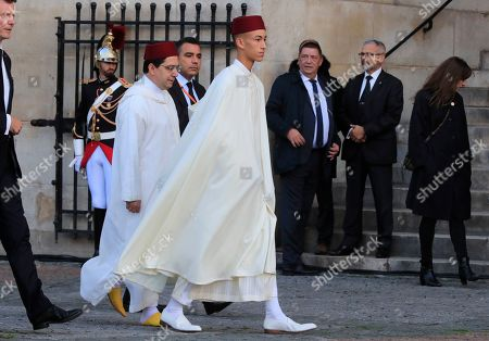 Moulay Hassan, Crown Prince of Morocco, center, arrives at Saint Sulpice Church in Paris, where past and current heads of states gathered to pay tribute to former French President Jacques Chirac who died last week at the age of 86