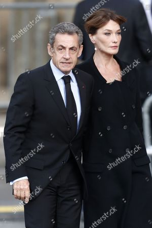 Former French President Nicolas Sarkozy (L) and his wife Carla Bruni Sarkozy (R) attend a memorial service for French former President Jacques Chirac, at the Church of Saint-Sulpice in Paris, France, 30 September 2019. Jacques Chirac died on 26 September in Paris, aged 86. The 30th September 2019 has been declared a day of national mourning in France.