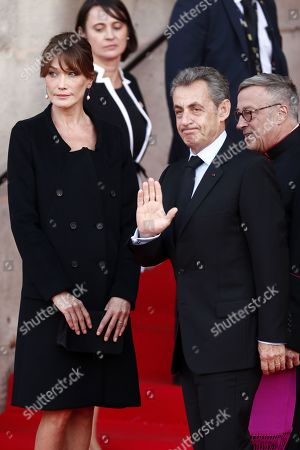 Former French President Nicolas Sarkozy (2-R) and his wife Carla Bruni Sarkozy (L) attend a memorial service for French former President Jacques Chirac, at the Church of Saint-Sulpice in Paris, France, 30 September 2019. Jacques Chirac died on 26 September in Paris, aged 86. The 30th September 2019 has been declared a day of national mourning in France.