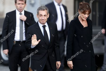 Former French President Nicolas Sarkozy (C) and his wife Carla Bruni Sarkozy (R) attend a memorial service for French former President Jacques Chirac, at the Church of Saint-Sulpice in Paris, France, 30 September 2019. Jacques Chirac died on 26 September in Paris, aged 86. The 30th September 2019 has been declared a day of national mourning in France.