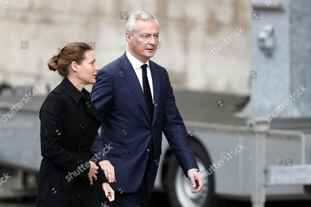 Stock Photo of French Finance Minister Bruno Le Maire (R) and his wife Pauline Doussau de Bazignan attend a memorial service for former French President Jacques Chirac at the Church of Saint-Sulpice in Paris, France, 30 September 2019. Jacques Chirac died on 26 September in Paris, aged 86. 30 September 2019 has been declared a day of national mourning.