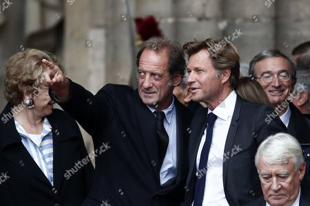 French actor Vincent Lindon (2-L) and French TV personality Laurent Delahousse (3-R) leave a memorial service for French former President Jacques Chirac, at the Church of Saint-Sulpice in Paris, France, 30 September 2019. Jacques Chirac died on 26 September in Paris, aged 86. The 30th September 2019 has been declared a day of national mourning in France.
