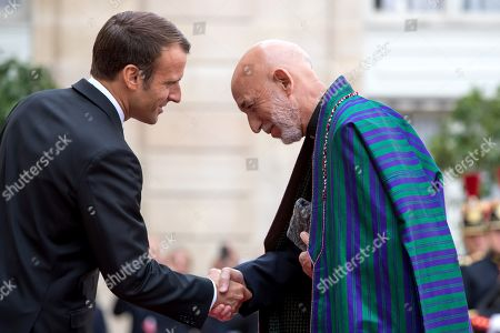 Stock Photo of French President Emmanuel Macron (L) welcome Former President of the Islamic Republic of Afghanistan Hamid Karzai (R), ahead of a lunch for the visiting leaders and heads of state, following a memorial for French former President Jacques Chirac, at the Elysee Palace in Paris, France, 30 September 2019. Jacques Chirac died on 26 September in Paris, aged 86. The 30th September 2019 has been declared a day of national mourning in France.