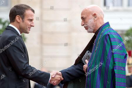 French President Emmanuel Macron (L) welcome Former President of the Islamic Republic of Afghanistan Hamid Karzai (R), ahead of a lunch for the visiting leaders and heads of state, following a memorial for French former President Jacques Chirac, at the Elysee Palace in Paris, France, 30 September 2019. Jacques Chirac died on 26 September in Paris, aged 86. The 30th September 2019 has been declared a day of national mourning in France.