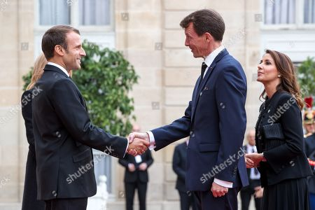 French President Emmanuel Macron (L) welcomes Princess Marie (R) and Prince Joachim (C) of Denmark, ahead of a lunch for the visiting leaders and heads of state, following a memorial for French former President Jacques Chirac, at the Elysee Palace in Paris, France, 30 September 2019. Jacques Chirac died on 26 September in Paris, aged 86. The 30th September 2019 has been declared a day of national mourning in France.
