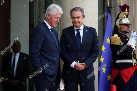 Former Prime Minister of Spain Jose Luis Rodriguez Zapatero (R) and US former President Bill Clinton (L) leave a lunch for the visiting leaders and heads of state, following a memorial for former French President Jacques Chirac, at the Elysee Palace in Paris, France, 30 September 2019. Jacques Chirac died on 26 September in Paris, aged 86. 30 September 2019 has been declared a day of national mourning.