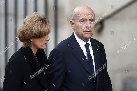 Stock Photo of Former Prime Minister Alain Juppe (R) and his wife Isabelle (L) attend a memorial service for French former President Jacques Chirac at the Church of Saint-Sulpice in Paris, France, 30 September 2019. Jacques Chirac died on 26 September in Paris, aged 86. The 30th September 2019 has been declared a day of national mourning in France.