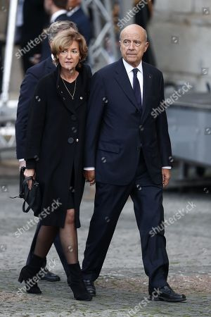 Former Prime Minister Alain Juppe (R) and his wife Isabelle (L) attend a memorial service for French former President Jacques Chirac at the Church of Saint-Sulpice in Paris, France, 30 September 2019. Jacques Chirac died on 26 September in Paris, aged 86. The 30th September 2019 has been declared a day of national mourning in France.