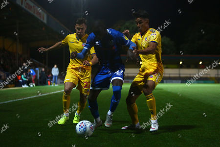 Dennis Politic and Adam Chicksen of Bolton battle Rochdale's Fabio Tavares