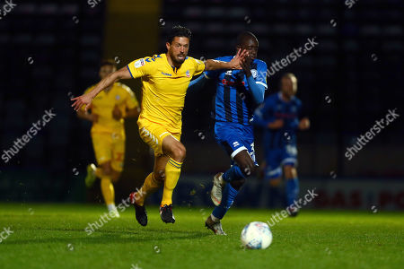 Jason Lowe of Bolton fends off Rochdale's Fabio Tavares