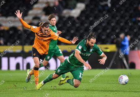 Jackson Irvine of Hull City fouls Atdhe Nuhiu of Sheffield Wednesday