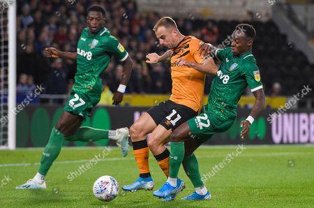 Kamil Grosicki of Hull City puts pressure on Moses Odubajo of Sheffield Wednesday