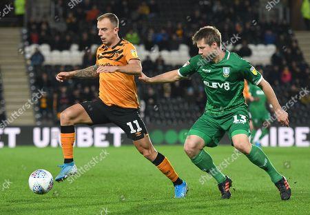 Kamil Grosicki of Hull City and Julian Borner of Sheffield Wednesday