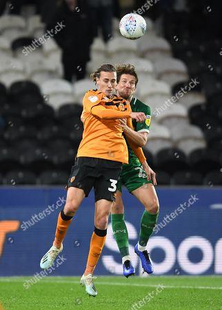 Jackson Irvine of Hull City and Sam Hutchinson of Sheffield Wednesday