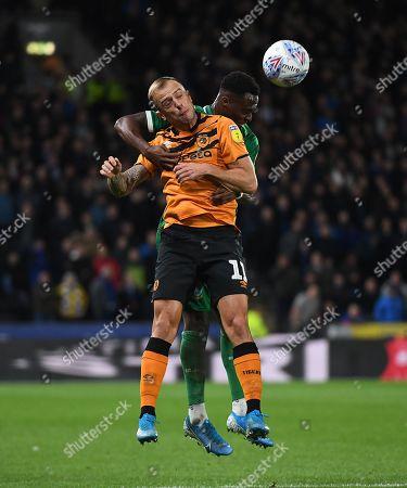 Kamil Grosicki of Hull City and Moses Odubajo of Sheffield Wednesday