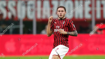AC Milan's Davide Calabria controls the ball during a Serie A soccer match between AC Milan and Fiorentina, at the San Siro stadium in Milan, Italy
