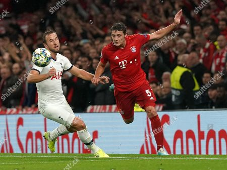 Harry Kane of Tottenham Hotspur challenged by  Benjamin Pavard of Bayern Munich