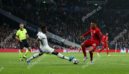 Serge Aurier of Tottenham Hotspur challenges Corentin Tolisso of Bayern Munich on the edge of the box