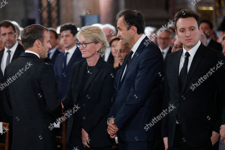 Claude Chirac, daughter of late French President Jacques Chirac (2-L) speaks with French President Emmanuel Macron while her husband Frederic Salat-Baroux (2-R) and son Martin Rey-Chirac look on before her father's final service at Saint Sulpice church, in Paris, France, 30 September 2019. Past and current heads of states are gathering in Paris to pay tribute to former French President Jacques Chirac who died last week at the age of 86.
