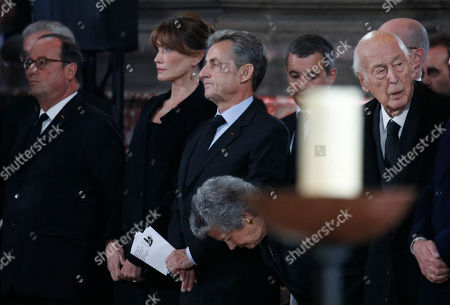 Former French President Valery Giscard d'Estaing (R) his wife Anne-Aymone, former President Nicolas Sarkozy and his Carla Bruni-Sarkozy and former President Francois Hollande (L) attend French President Jacques Chirac's final service at Saint Sulpice church, in Paris, France, 30 September 2019. Past and current heads of states are gathering in Paris to pay tribute to former French President Jacques Chirac who died last week at the age of 86.