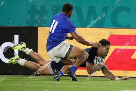 Samoa's Ed Fidow, left, slides into Scotland's Sean Maitland during the Rugby World Cup Pool A game at Kobe Misaki Stadium between Scotland and Samoa in Kobe City, Japan