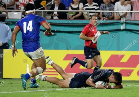 Scotland's Sean Maitland falls over the line to score a try during the Rugby World Cup Pool A game at Kobe Misaki Stadium between Scotland and Samoa in Kobe City, Japan