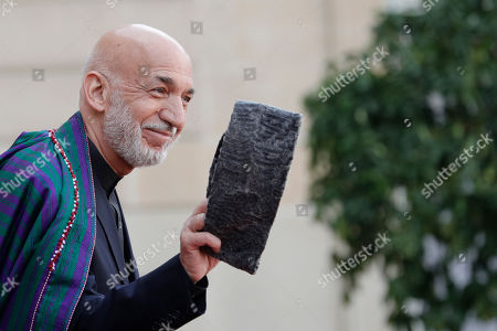 Stock Image of Former Afghan President Hamid Karzai leaves the Elysee Palace after a lunch with heads of states and officials, in Paris. France bid a final adieu to former French President Jacques Chirac on Monday as he received military honors on a national day of mourning that culminated with a memorial service attended by dozens of past and current world leaders
