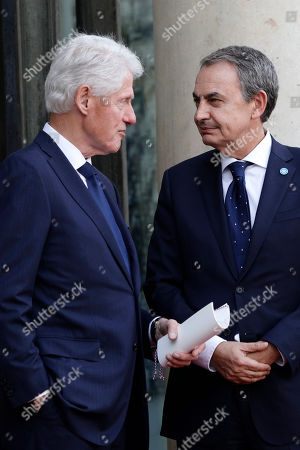 Former U.S President Bill Clinton and former Spanish Prime Minister Jose Luis Zapatero leave the Elysee Palace after a lunch with heads of states and officials, in Paris. France bid a final adieu to former French President Jacques Chirac on Monday as he received military honors on a national day of mourning that culminated with a memorial service attended by dozens of past and current world leaders