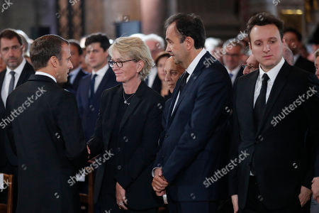 Claude Chirac, daughter of late French President Jacques Chirac, second left, speaks with French President Emmanuel Macron while her husband Frederic Salat-Baroux, second right, and son Martin Rey-Chirac look on before her father's final service at Saint Sulpice church, in Paris. Past and current heads of states are gathering in Paris to pay tribute to former French President Jacques Chirac who died last week at the age of 86