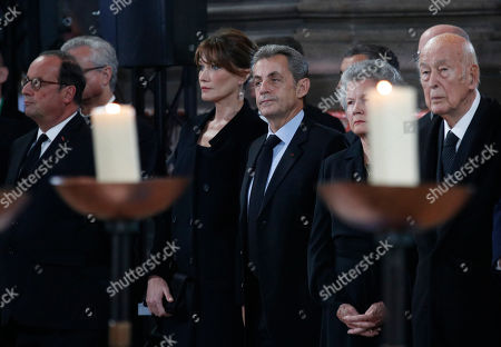 Former French President Valery Giscard d'Estaing, right, his wife Anne-Aymone, former President Nicolas Sarkozy and his Carla Bruni-Sarkozy and former President Francois Hollande, left, attend French President Jacques Chirac's final service at Saint Sulpice church, in Paris. Past and current heads of states are gathering in Paris to pay tribute to former French President Jacques Chirac who died last week at the age of 86