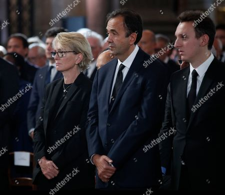 Claude Chirac, left, her husband Frederic Salat-Baroux and her son Martin Rey-Chirac attend French President Jacques Chirac's final service at Saint Sulpice church, in Paris. Past and current heads of states are gathering in Paris to pay tribute to former French President Jacques Chirac who died last week at the age of 86