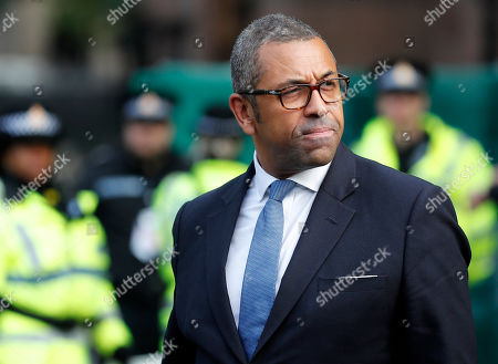 Conservative party chairman James Cleverly leaves his hotel at the Conservative Party Conference in Manchester, England, . Prime Minister Boris Johnson has vowed that Britain will leave the European Union on the scheduled date of Oct. 31, with or without a divorce deal governing future relations with the bloc